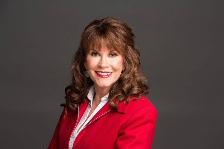 """Cheri Slaughter, winner of America Auto Auction's August Spotlight Award, says it's important to listen to what customers say, even if they're upset about something. """"Stopping, focusing on them, and listening makes them feel they're important to our business."""" - Photo: America's Auto Auction"""