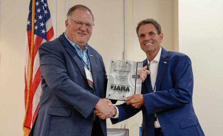 Tony Long recognized Paul Seger's two-year term as IARA President, which ended Aug. 26. - Photo: IARA