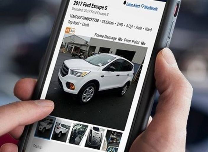 Vehicle bidders now have a streamlined way of accessing live, auctioneer-led sales, more information at their fingertips and a better experience with live video streams. - Photo: Manheim