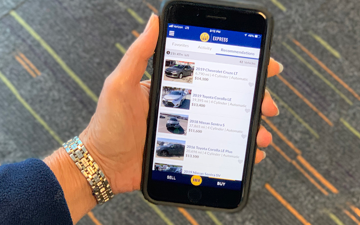 The latest upgrades to Manheim's mobile app were designed to provide dealers greater control with offer management and personalized vehicle recommendations.  - Photo courtesy of Manheim.