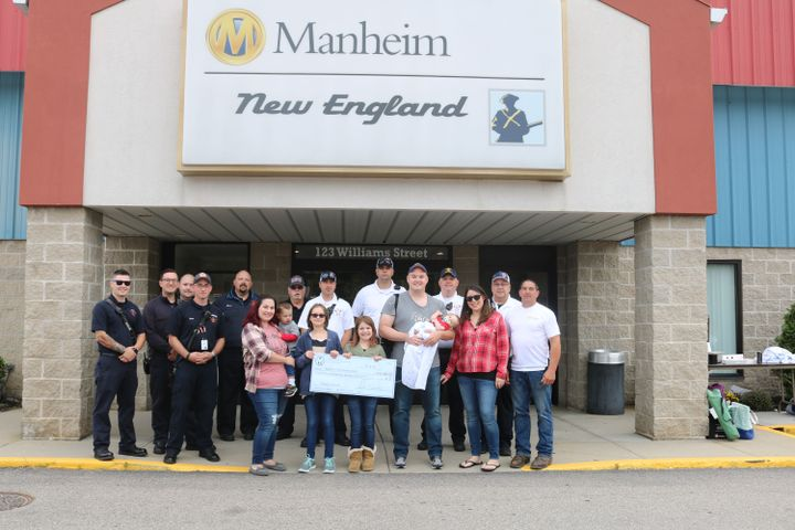 In addition to hosting the event and providing employee volunteers, the auction also donated $5,000 to Dighton Firemen's Association.   - Photo courtesy of Manheim.