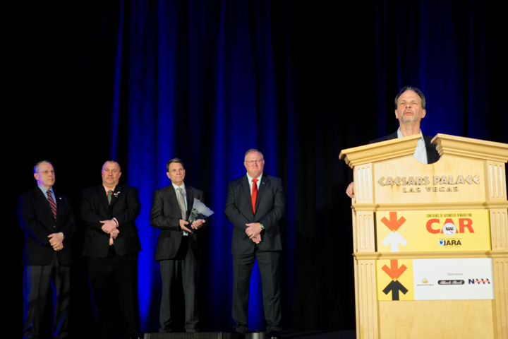 Nick Peluso receiving the Bobit Industry Icon Award at the 2019 Conference of Automotive Remarketing. 