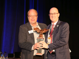 Editor of Automotive Fleet, Mike Antich (l) prsented Warren Byrd, EVP Corporate Development and...