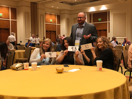 Attendees playfully scored how well Standards Committee Co-Chair Matt Arias did during his...