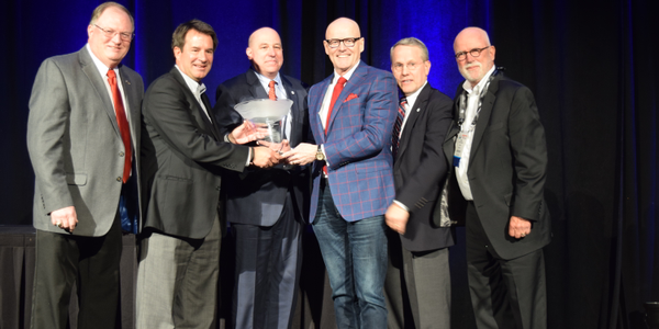 Hallett received the Ed Bobit Industry Icon award at the Conference of Automotive Remarketing....