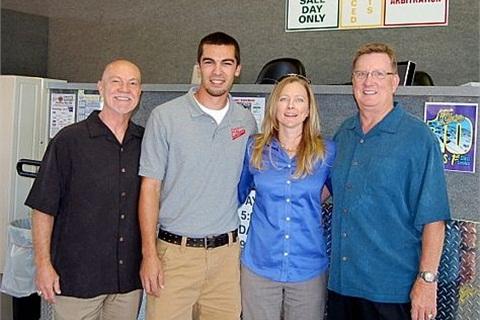 John Poteet (left), with three key members of the management team at Louisiana's 1st Choice Auto Auction: Matt Alombro, Bridget Higginbotham and Don Sistrunk.