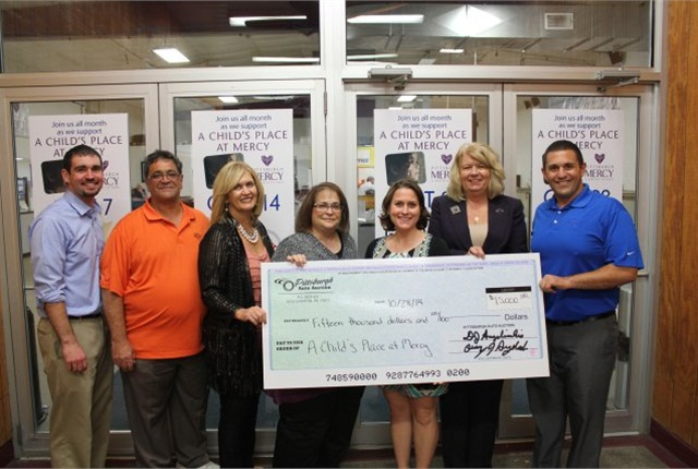 (L-R) Kevin Jackson, Denny Angelicchio, Doreen Angelicchio, Debbie Angelicchio-Jackson, Shelly Walker, and Chris Angelicchio (far right) as they present a check for $15,000 to Joan Mills (second from right) from A Child's Place at Mercy. (PHOTO: PAA)
