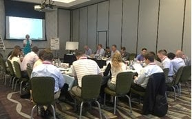 Auction Academy's Class 4 Group met at DAA Northwest in July, where they heard lectures on auction culture and staging promotion sales while watching the largest auction promotion in the country unfold before them. (PHOTO: TPC Management)