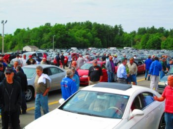 Customers preview inventory at the Dealer Appreciation Sale atAuto Auction of New England. (Photo: ServNet)