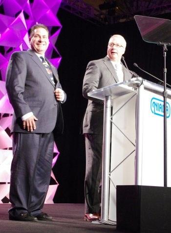 Frank Fuzy (left) is introduced by Black Book Vice President Tim West.(PHOTO: NIADA)