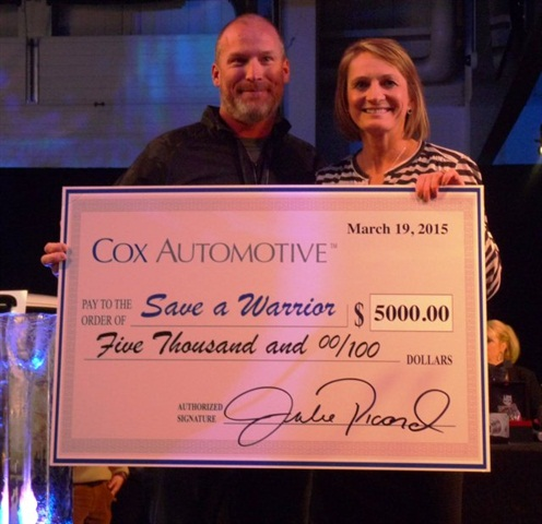 """Prior to the start of the charity auction on March 19, Manheim Pennsylvania Vice President and GM Julie Picard, right, presented Ronald """"Jake"""" Clark, founder & executive director of Save A Warrior, with a $5,000 donation to Save A Warrior from Cox Automotive, Kelley Blue Book and NextGear Capital, Inc."""