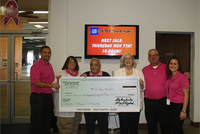 (L-R)Pittsburgh Auto Auction General Manager, Chris Angelicchio, joins family and staff Debbie Angelicchio-Jackson, Clo Angelicchio, Kathy Purcell, Dave Angelicchio and Shelly Walker as they present a check for $13,130 to the Susan Koman Foundation.