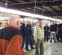 The Barber family hosted the ServNet Fall Owners' Meeting at State Line Auto Auction, where owner Jeff Barber leads a tour of the auction facility.