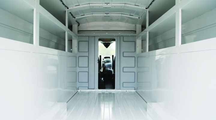 Knapheide's ABS thermoformed partition is crash-tested up to 7,000 pounds, partially sealed to keep HVAC systems up front with the driver, and designed to allow full driver seat travel. All this is done with the safety of the driver in mind. - Photo: Knapheide