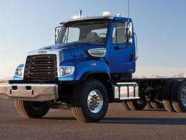 Freightliner 114SD     The 114SD was designed with a clear back-of-cab platform for ease in...