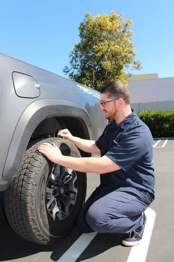 Mobile maintenance services may cost more up-front that traditional service facilities, but the time savings and reduced vehicle wear-and-tear can save costs in the long run. - Photo: YourMechanic.com