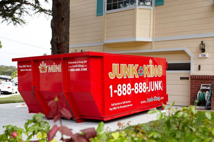 Junk King also provides driveway friendly mini-dumpsters it can drop off and come back to pick up at the customer's convenience. - Photo: Junk King