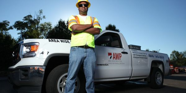 John Harris, an Estimator out of the company's corporate office, stands by one of the company's...
