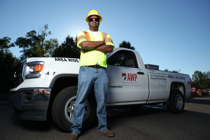 John Harris, an Estimator out of the company's corporate office, stands by one of the company's vehicles. - Photo: Area Wide Protective