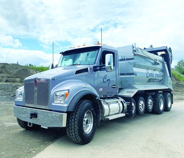 Looker primarily uses the trucks to pave, grind, and haul aggregate. However, due to wet Washington weather, they also do some dirt work. - Photo: Kenworth