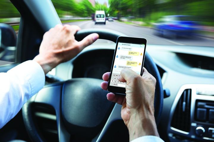 People of all ages have become addicted to their mobile devices, and this can have dire consequences on the road. - Photo: Gettyimages.com/AndreyPopov
