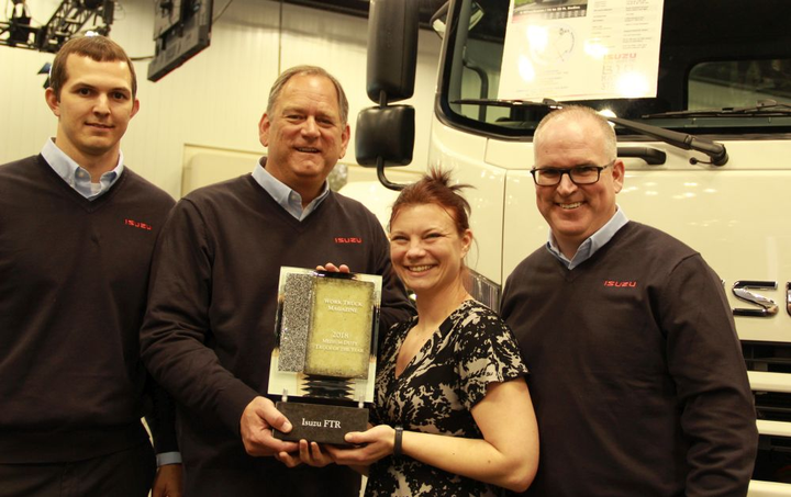 Work Truck's Executive Editor, Lauren Fletcher (second from right) presents the Medium-Duty Truck of the Year award to (l-r) ICTA's Tim Ellsworth, product planning manager; Shaun Skinner, president; and Brian Tabel, executive director, marketing.