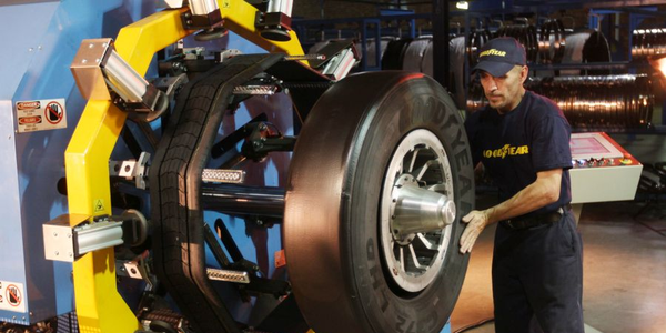 Goodyear UniCircle treads are spliceless and positioned onto casings using laser-guided...