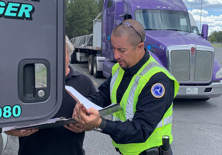 An inspector shows a driver how to transfer his hours of service log at roadside – something that you have to be able to do with ELDs that you didn't with AOBRDs.  - Photo courtesy CVSA