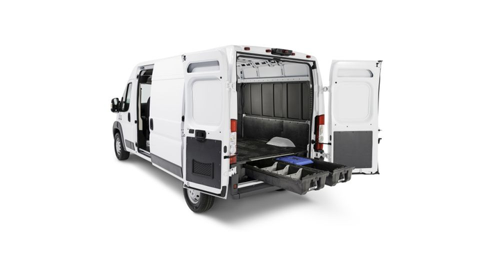 The DECKED system weighs only 220 pounds and attaches to the van bed. It features two system-length drawers, which can hold a 200-pound load each, gliding on heavy-duty wheels beneath a deck with a 2,000-pound payload capacity. 