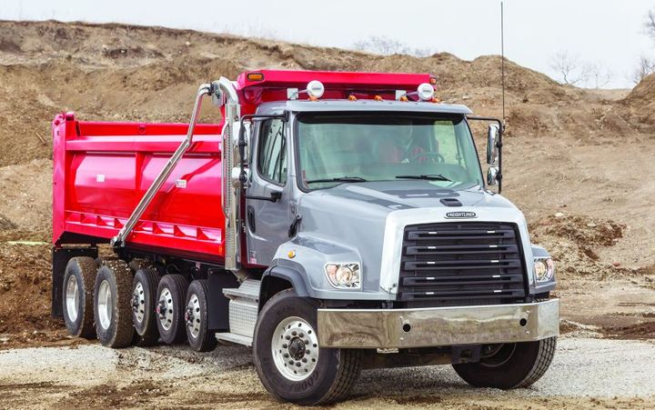 The 114 SD, pictured here with a dump body, offers 260-505 hp up to 1,850 lb.-ft. of torque, and a 92,000-pound GVW. 