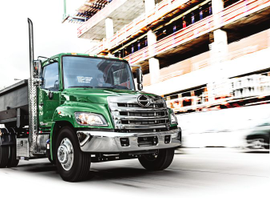 Hino's Model 238 truck is a medium-duty conventional truck with a 23,000-pound GVW powered by...