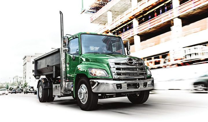 Hino's Model 238 truck is a medium-duty conventional truck with a 23,000-pound GVW powered by Hino's J08E-WU 8L engine. It delivers 230 hp and 520 lb.-ft. of torque.