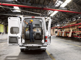 Full-size vans such as the Nissan NV Cargo combine heavy-duty capacity with an enclosed cargo hold and an available high roof.