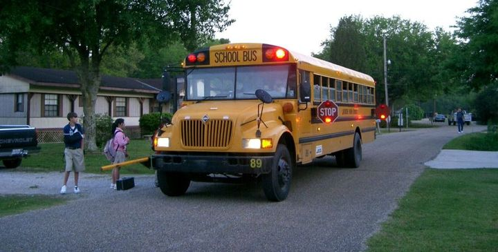 Know your state laws regarding passing (or not passing) school buses. When a school bus has its red lights flashing and stop signal arm extended, it is a violation of traffic laws to pass.  - Photo courtesy of Wikimedia Commons