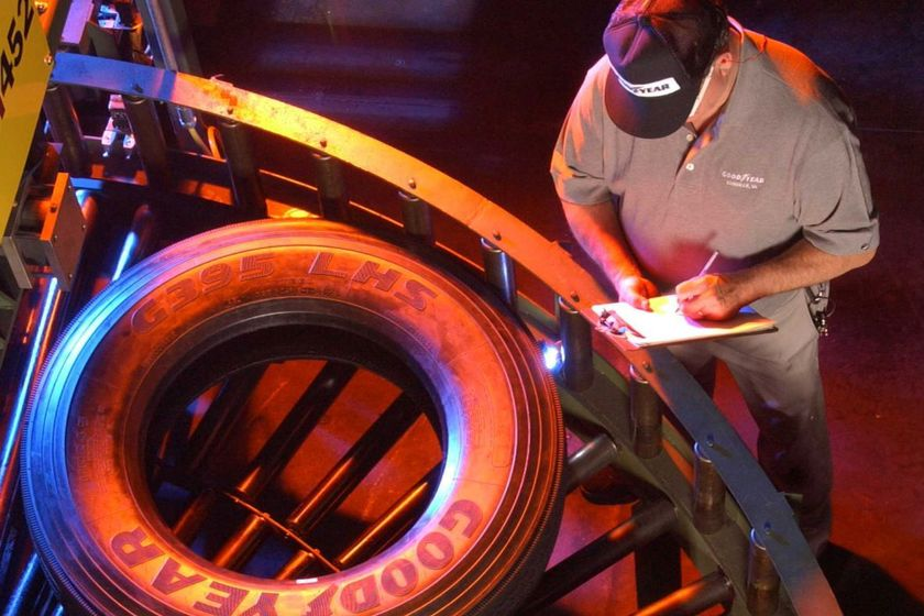 A Goodyear Tire & Rubber Company associate keeps a watchful eye on truck tires traveling through...