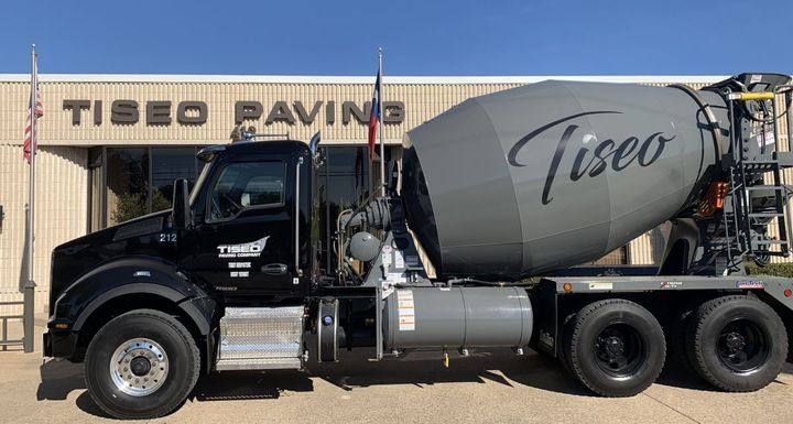 The Tiseo Paving fleet is easy to spot. They're all black, with matching gray on the mixer bodies. - Photo: Kenworth
