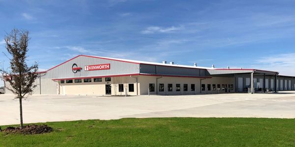 The 53,000 square-foot building features a 24-bay service department that provides truck...