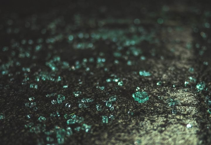 - Photo of broken car window glass via Unsplash/Jamie Street