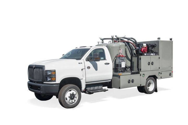 The 55AB-6200 is available with up to five fluid tanks ranging from 60 to 180 gallons, and the Sage Oil Vac exclusive pressure and vacuum system enables vacuum filling from bulk tanks on the driver's side of the machine. - Photo: Sage Oil Vac