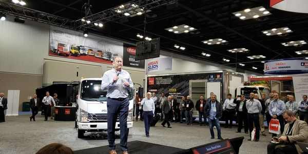 Isuzu Commercial Truck of America President Shaun Skinner addresses the crowd at The Work Truck...