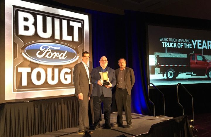 (l-r) Rob Peruzzi, commercial sales manager for Ford US Fleet Operations andMike Pruitt, chief program engineer for commercial vehicles accepted the award from Chris Brown, executive editor from Bobit Business Media at The Work Truck Show. -
