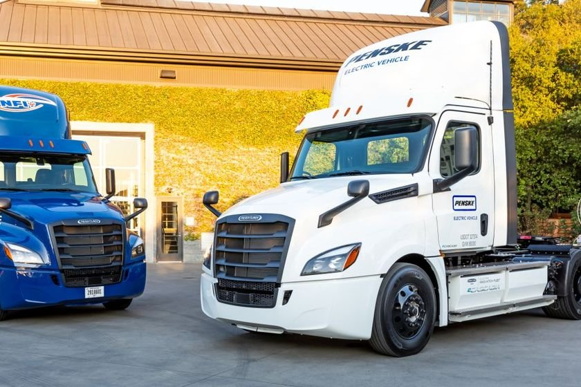 The first Freightliner eCascadias delivered to NFI (left) and Penske (right).