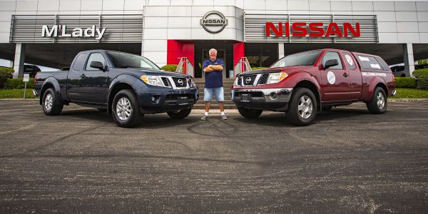 Brian Murphy shows off his million-mile 2007 Nissan Frontier (right) and his brand-new 2020-MY...