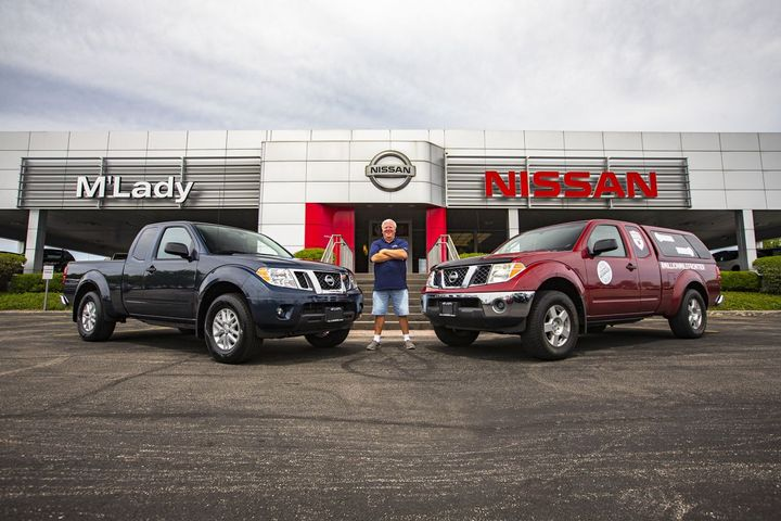 Brian Murphy shows off his million-mile 2007 Nissan Frontier (right) and his brand-new 2020-MY replacement. - Photo: Nissan