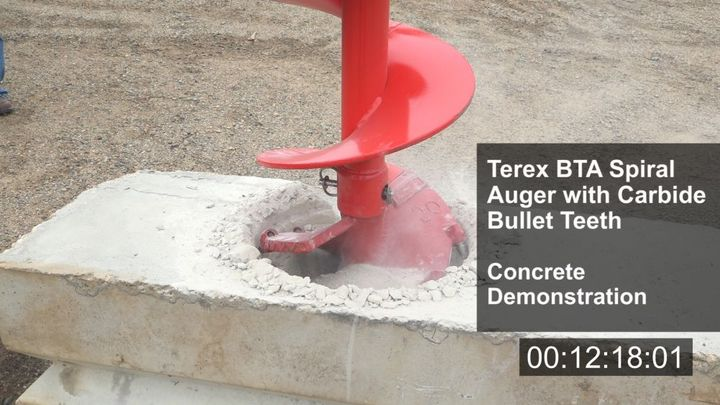 In the video, Terex Utilities performs a side-by-side comparison of its TXC Auger and BTA Spiral with carbide bullet teeth drilling into the concrete. - Photo: Terex Utilities