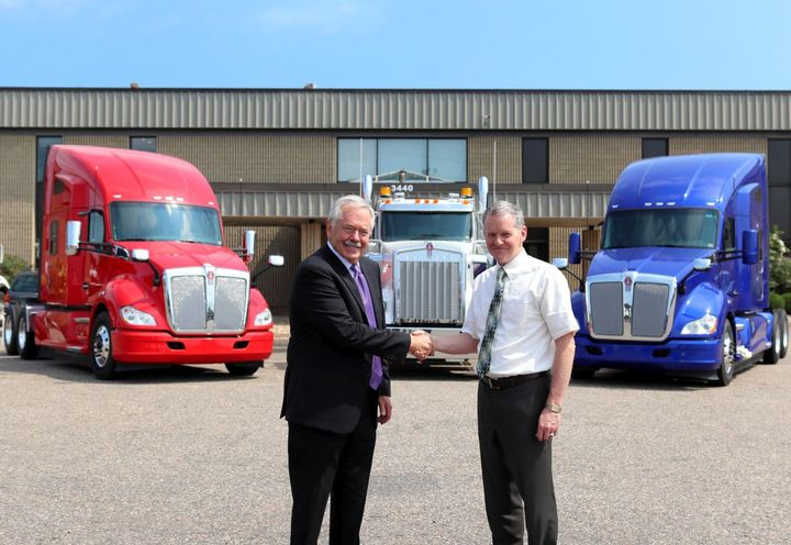 Jim Hartman (left) and Kyle Treadway, third generation Dealer Principal for Kenworth Sales Company, shake on their new partnership. - Photo: Kenworth