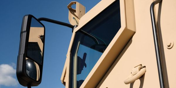 Mack Defense has partnered with XPER for transparent armor on its heavy-duty dump truck.