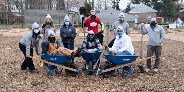 Part of its effort to give back in 2020, approximately 20 Bestpass employees built garden beds...