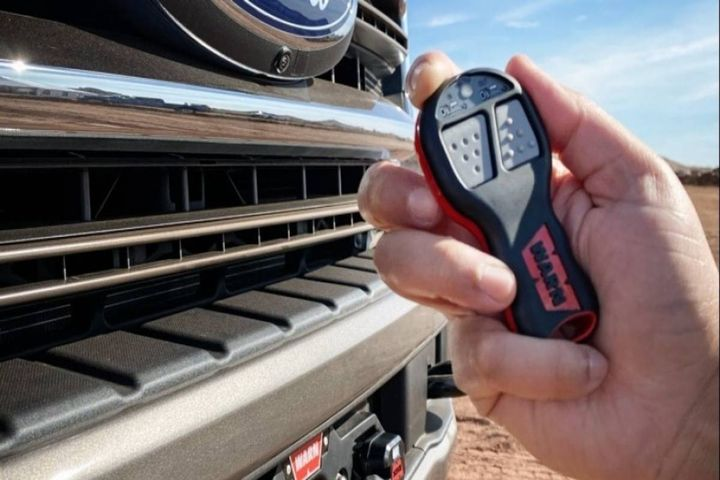 The winch includes both a wireless and wired remote control. - Photo: Ford