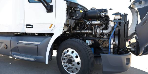 A photo of a three-cylinder 10.6L heavy-duty diesel engine, part of a project funded by the...
